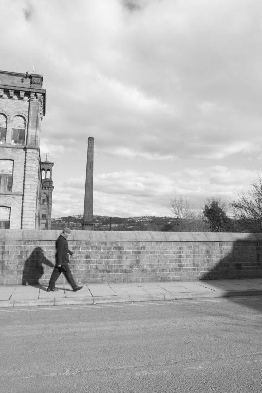 Man in a flat cap, Saltaire.